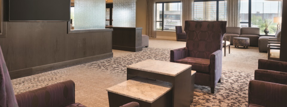 Lobby with comfy seating and wall-mounted, flat-panel TV