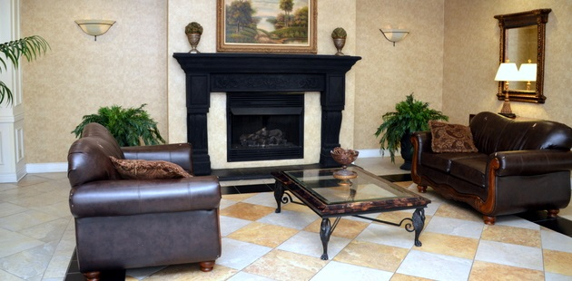 A fireplace and plush seating in our hotel lobby