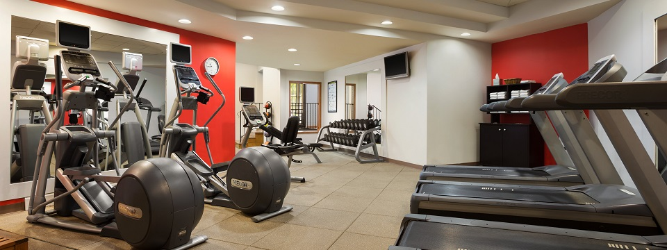 Hotel fitness center with treadmill, elliptical and free weights