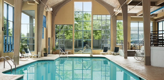 Indoor pool with a high ceiling and plenty of natural light