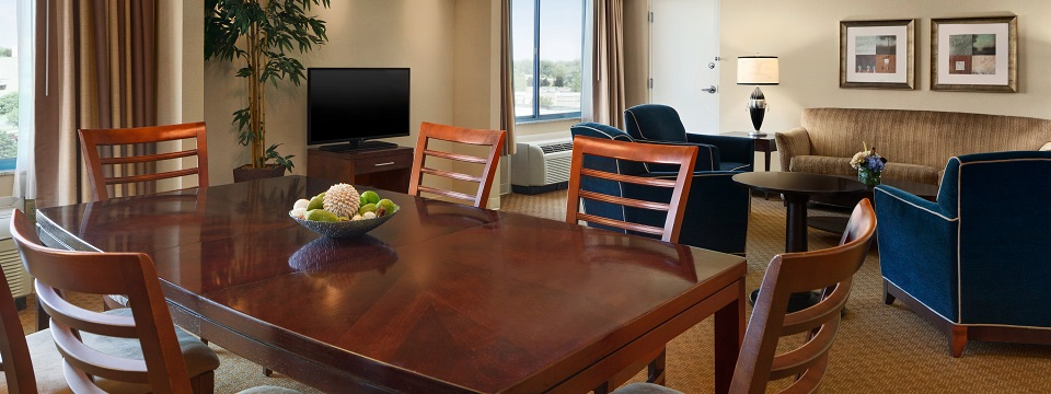 Presidential Suite living room with sofa, chairs and dining table