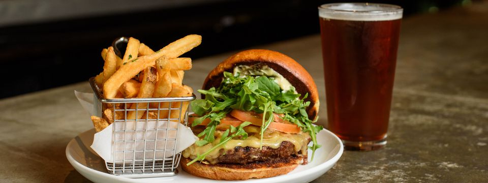 Cheeseburger, fries and a beer at Copper Canyon Grill