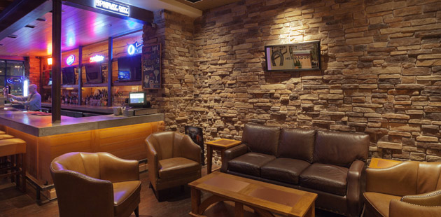 Seating area and bar at the Copper Canyon Grill House & Tavern
