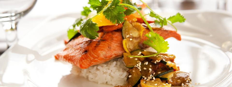 Colorful salmon and rice entrée at RBG Bar & Grill