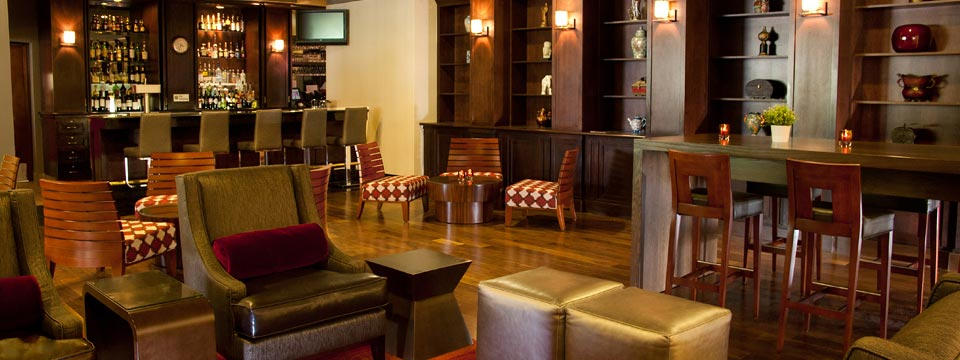 Hotel's spacious lounge with bar and table seating