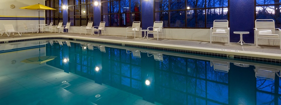 Indoor pool with patio chairs at the Radisson in Seattle