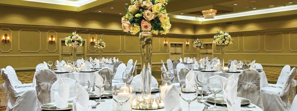 Seattle hotel's wedding reception venue decorated with flowers and linens
