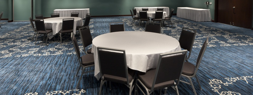 Banquet space with tables and chairs