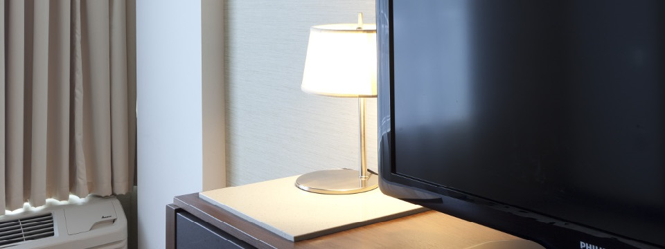 Close-up of lamp and TV