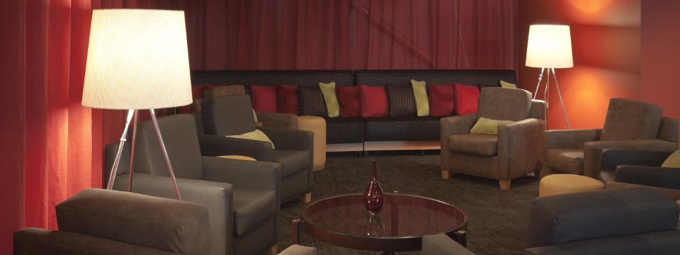 Sofa and armchairs in lounge area of RBG Bar & Grill