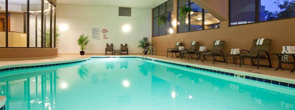 Indoor pool with deck chairs