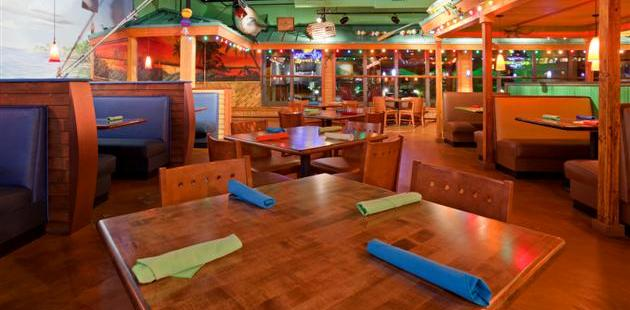 Tables at Jimmy's Island Grill with colorful napkins and lights