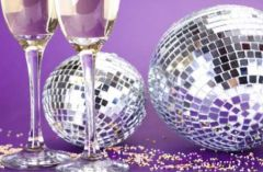Champagne glasses, disco balls and confetti