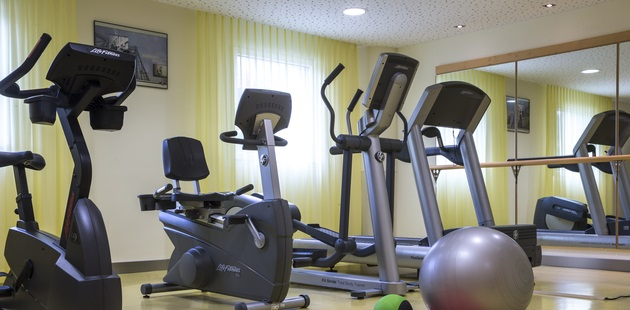 Fitness centre with treadmill, elliptical and stationary bikes