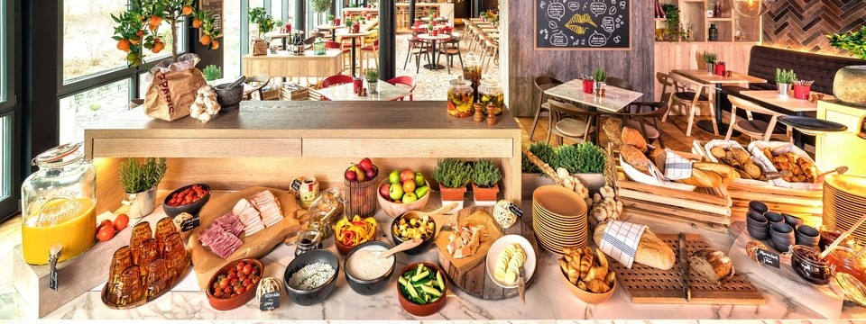 Breakfast buffet with fruit, cold cuts and juice
