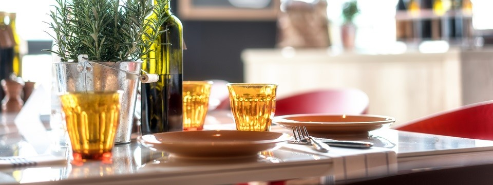 Simple, elegant table settings with olive oil on table