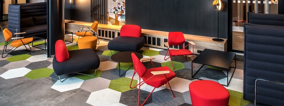 Colourful seating and mural in lobby