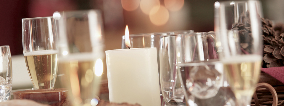 Table setting with champagne glasses and a candle