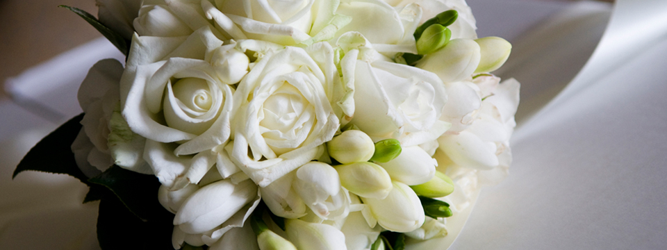 White rose bouquet on table in Red Deer event venue