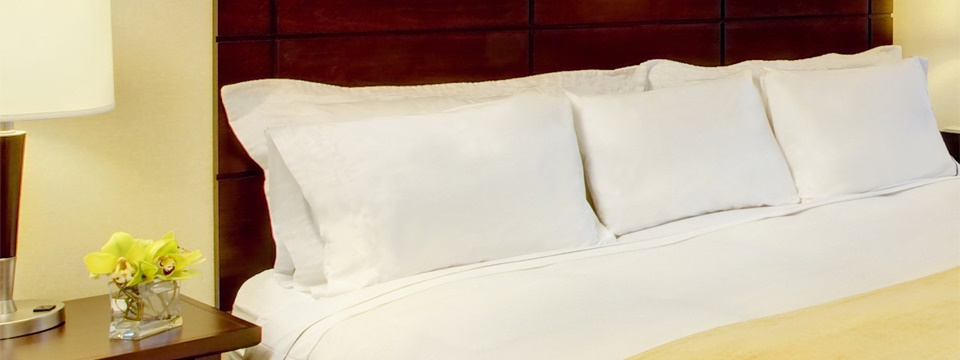 Plush king bed in our trendy St. Joseph hotel room